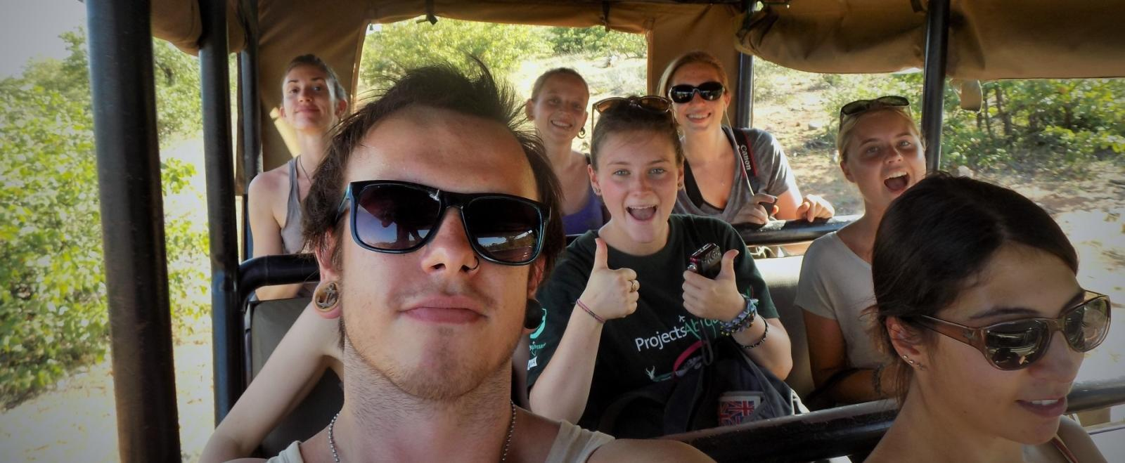 A safari vehicle tours the bushveld with the Projects Abroad volunteers in Botswana.